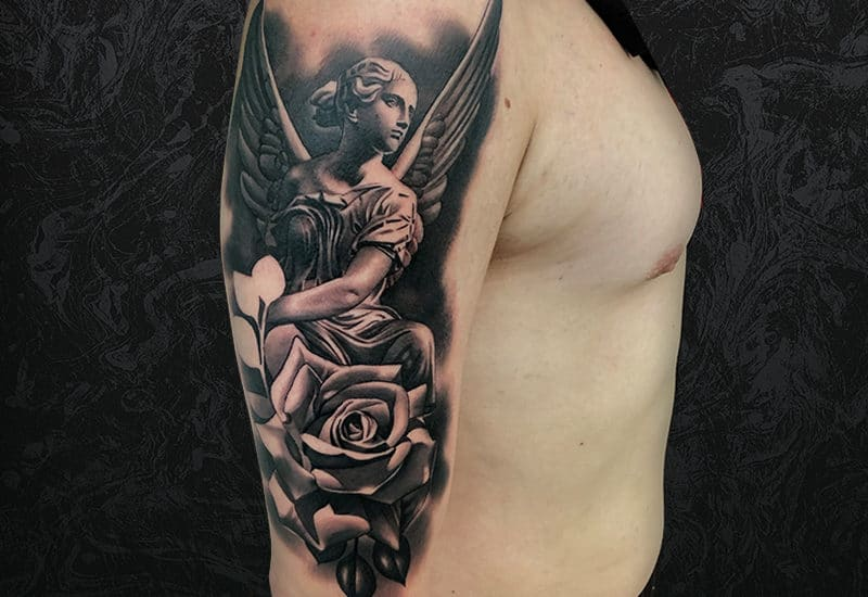 Angel Statue Arm Tattoo