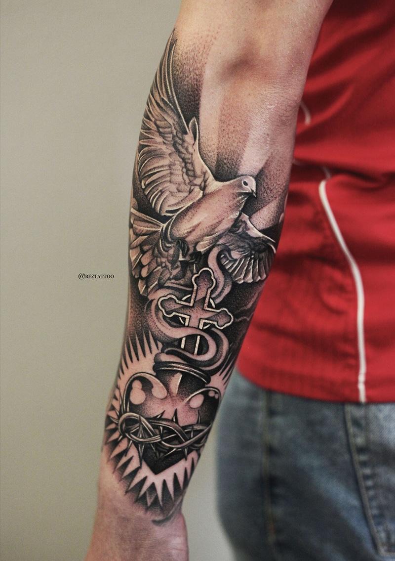 Dove Cross Arm Tattoo